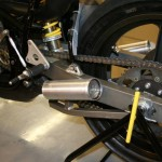 Swing arm/exhaust
